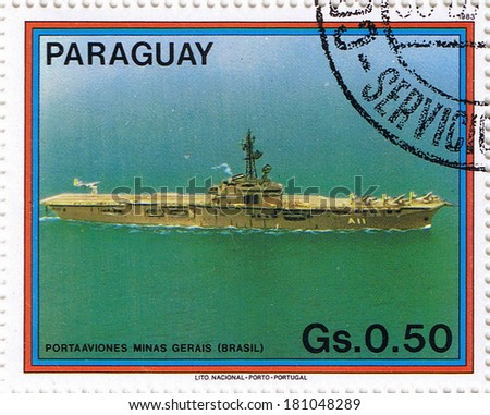 PARAGUAY -?? CIRCA 1983: stamp printed in Paraguay, shows aircraft carrier, series, circa 1983 - stock photo
