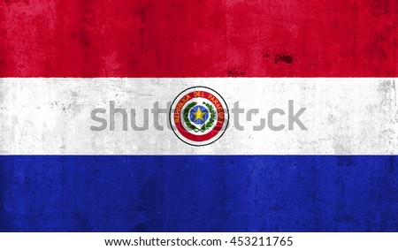 Paraguay country flag with grunge wall texture background. - stock photo