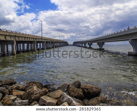Parallel Bridges span Tampa Bay one bridge is for foot traffic the other is for vehicle traffic. - stock photo