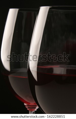 Parallel glasses of wine on a black background - stock photo