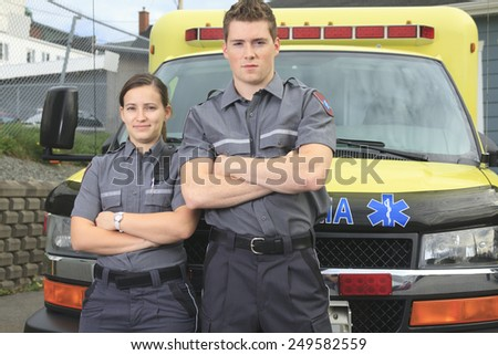 Paramedic employee with ambulance in the background