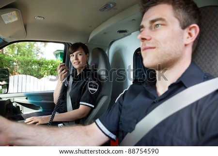 Paramedic team in an ambulance interior driving to destination - stock photo