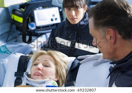 Paramedics With Patient - stock photo