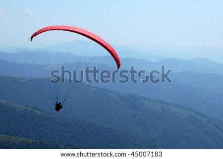 paraplane above mountains - stock photo