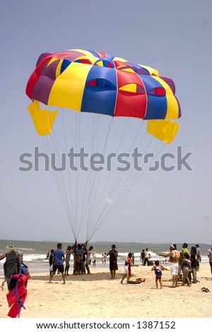 Parasail on the beach in Goa - stock photo