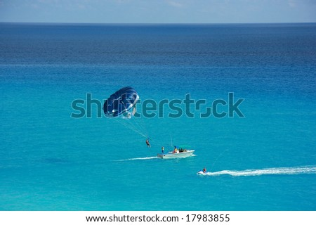 Parasailing and Jetskiing in the Caribbean - stock photo