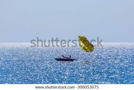 Parasailing in a blue sky in Alanya - stock photo