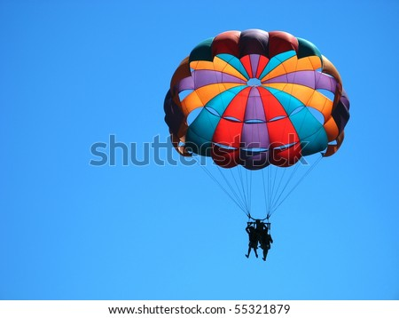 parasailing in the clear sky - stock photo