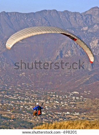 Parasailing peacefully overlooking Salt Lake Valley, Utah - stock photo