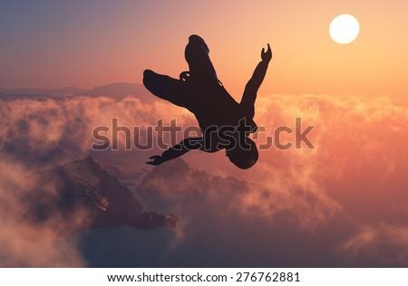 Parashutist against the blue sky. - stock photo