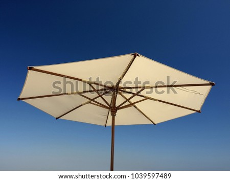 Parasol against clear blue sky