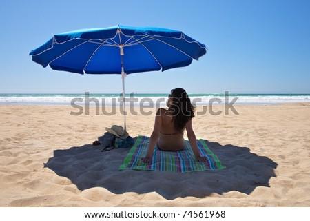parasol at Conil Beach in Cadiz Andalusia Spain - stock photo