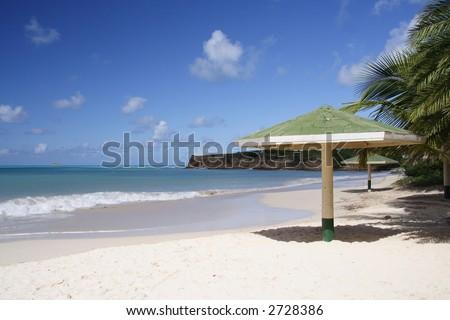 Parasol on a caribbean beach - stock photo
