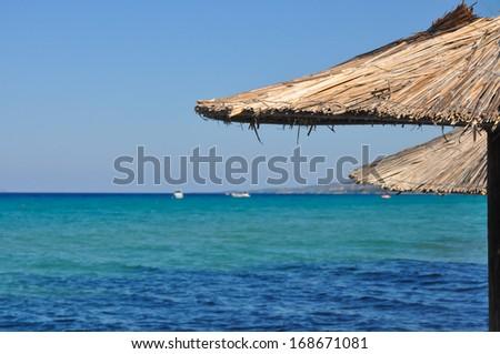 Parasol On A Sunny Beach - stock photo