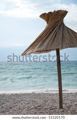 parasol on the beach in the mediterranean - stock photo