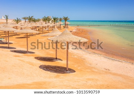 Parasols on the beach of Red Sea in Hurghada, Egypt
