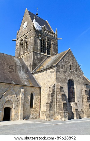 Paratrooper hanging from church, St. Mere Eglise, Normandy, France - stock photo