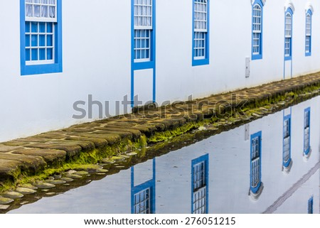 Paraty, Rio de Janeiro, Brazil. Every day the tide rises and seawater invades the city providing a unique natural spectacle. The streets become water mirrors that reflect all the beauty of the city. - stock photo