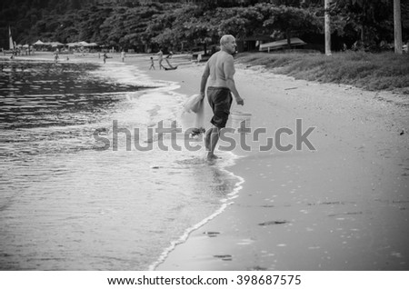 Paraty, RJ, BRAZIL - JANUARY - fisherman out of the sea with a result of fishing  - Latin America, on January 16, 2016, in Paraty, RJ, Brazil.