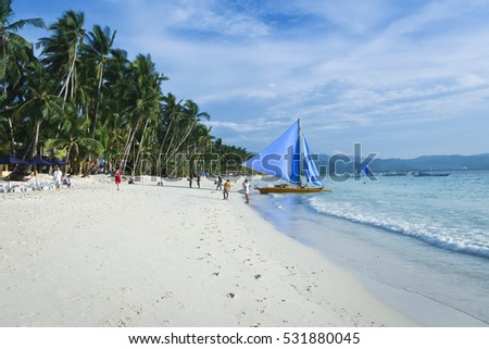 paraw outrigger sailboats on boracay white beach popular tourist destination in the philippines