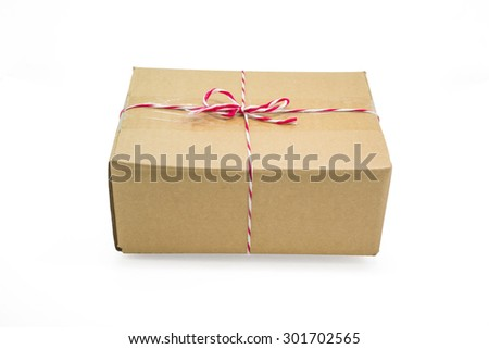 Parcel cardboard box and tied with string, isolated on white background - stock photo