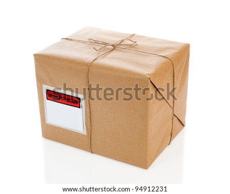 Parcel on white background with blank delivery label - stock photo
