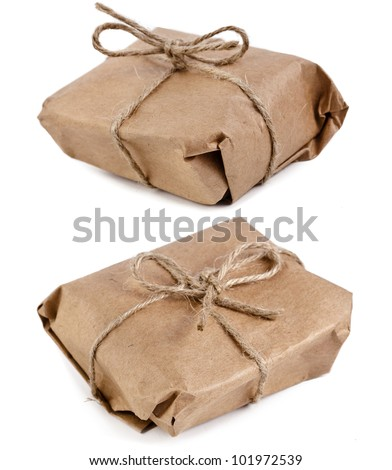 parcel package  wrapped with brown kraft paper tied rope  isolated on white - stock photo