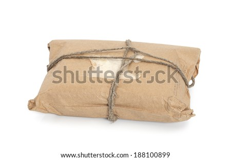 Parcel  tied with a string, isolated on white background  - stock photo