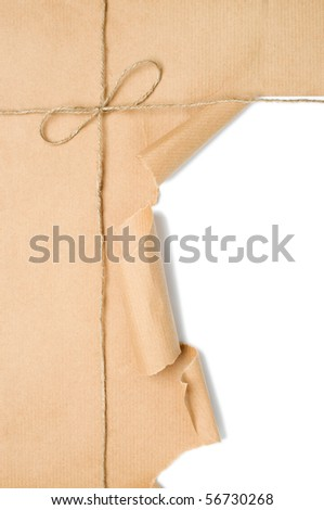 Parcel tied with string with corner open to reveal white copy space - stock photo