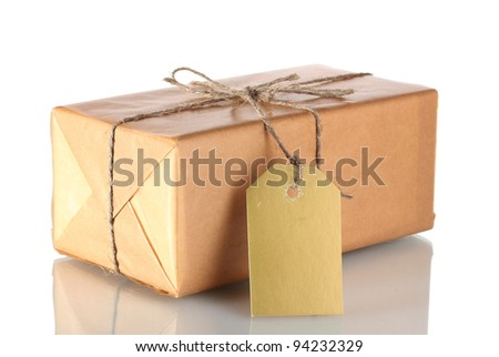 Parcel wrapped in brown paper tied with twine and with blank label isolated on white