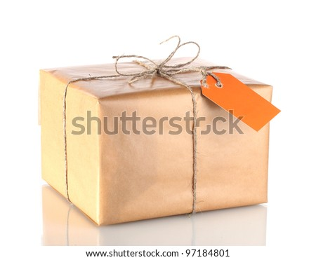 Parcel wrapped in brown paper tied with twine and with blank label isolated on white - stock photo