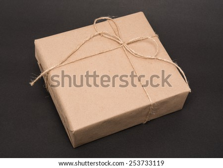 parcel wrapped packaged box on grey background
