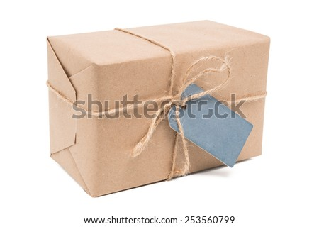 parcel wrapped packaged box with label isolated on white background - stock photo