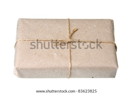 parcel wrapped with brown kraft paper isolated on white background - stock photo