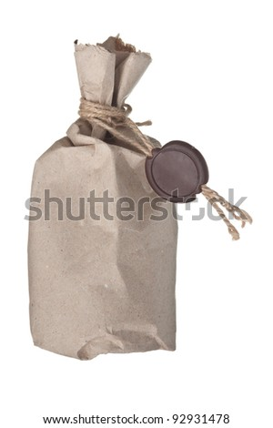 parcel wrapped with brown kraft paper with a wax seal isolated on white background - stock photo