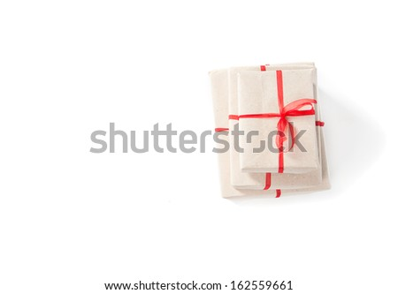 Parcel wrapped with brown paper - stock photo