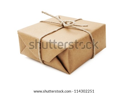 Parcel wrapped with brown paper and tied with string - stock photo