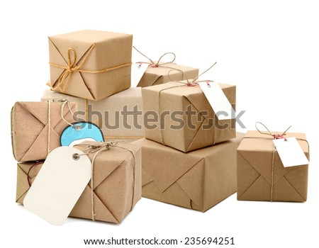 parcel wrapped with brown paper tied with rope on white background  - stock photo