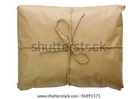 Parcel wrapped with brown paper, tied with string - stock photo