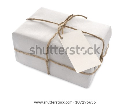 Parcel wrapped with  paper, tied with string and with blank label
