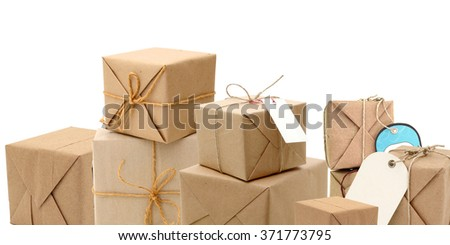 parcels boxes with kraft paper , isolated on white - stock photo