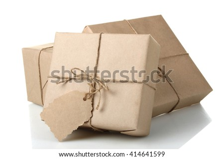 parcels with tag on white isolated background.The concept of Delivery