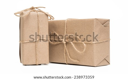 parcels wrapped in brown paper and tied with rough twine