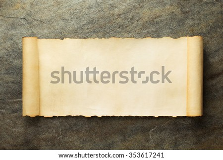 parchment scroll at old background - stock photo