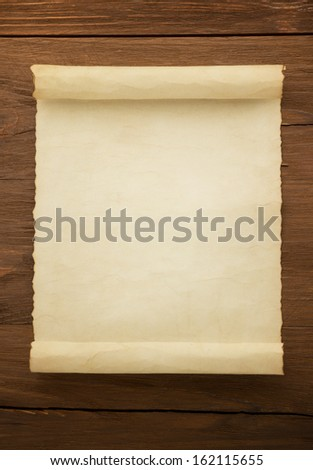 parchment scroll on wood background