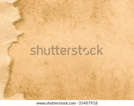 Parchment texture with torn paper accent on left - stock photo