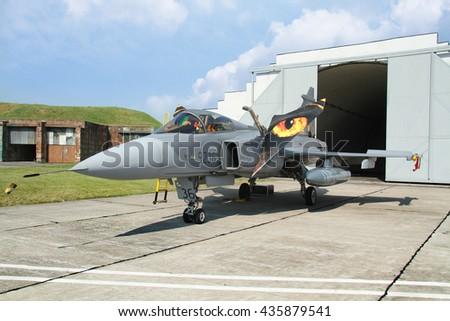 PARDUBICE, CZECH REPUBLIC - 29 May 2016: Aircraft JAS 39 C Gripen in aviation fair and century air combats, Pardubice, Czech Republic on 29 May 2016 - stock photo