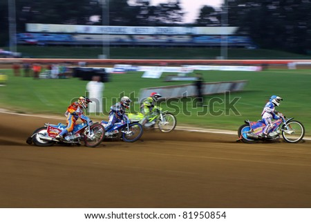 PARDUBICE, CZECH REPUBLIC - OCTOBER 1: Unidentified riders participate at Golden ribbon Word Championship Juniors of speedway on October 1, 2010 in Pardubice, Czech Republic - stock photo