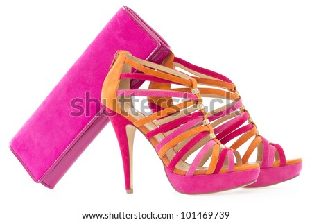 Pare of pink and orange shoes with a matching bag, isolate on white background - stock photo