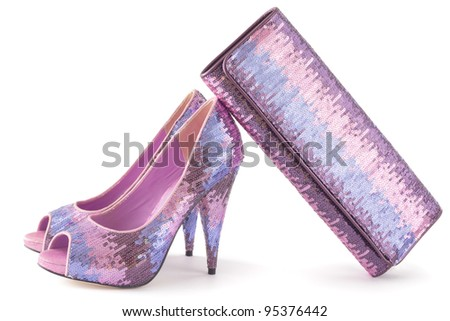 Pare of pink shiny shoes and matching bag isolate on white background - stock photo